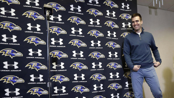 Baltimore Ravens quarterback Joe Flacco walks up to a microphone before speaking at a news conference at the team's practice facility in Owings Mills, Md., Monday, March 4, 2013. Flacco agreed to a contract that will make him the richest quarterback in NFL history after leading the Ravens to a Super Bowl XLVII victory over the San Francisco 49ers. (AP Photo/Patrick Semansky)
