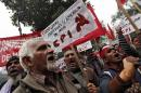 Supporters of CPI hold placards and anti-U.S. slogans during a protest near the American Center in New Delhi