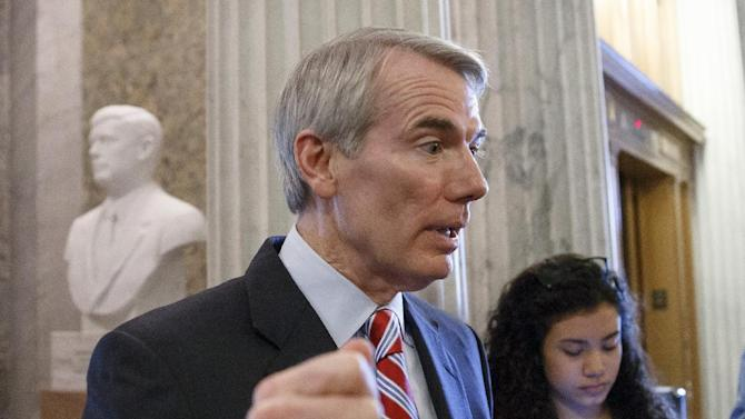 FILE - In this May 12, 2014 file photo, Sen. Rob Portman, R-Ohio speaks on Capitol Hill in Washington.  The Senate approved a long-delayed bill to boost energy efficiency Friday that includes incentives to cut energy use in commercial buildings, manufacturing plants and homes.  (AP Photo, File)