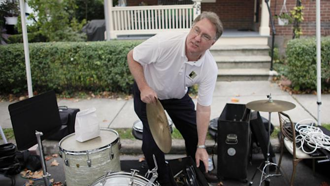 """Rick Renz, who plays drums in a """"Jazz with Friends"""" band,  packs away his instrument, Saturday Oct. 6, 2012,  in Doylestown Pa. Renz, 58, a sales manager, says he has never felt so disheartened about his country. His two older children, ages 33 and 27, both with masters degrees, have had to move back home because they can't find jobs. And he has witnessed friends lose jobs or have their homes foreclosed on.  (AP Photo/ Joseph Kaczmarek)"""