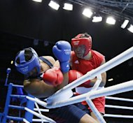 Dominic Breazeale (L) of the USA defends against Magomed Omarov (R) of Russia during their round of 16 Super-heavyweight (91+kg) boxing match of the London 2012 Olympics at the ExCel Arena in London. Omarov was awarded a 19-8 points decision