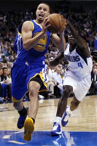 Curry steps up in 4th and OT as Warriors beat Mavs