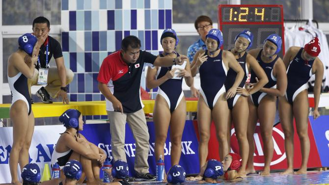 Japan's team head coach Fujiwara gives instructions to his players during their Women's Single Round Robin water polo match against Kazakhstan at the Dream Park Aquatics Centre during the 17th Asian Games in Incheon