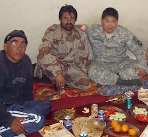 "This 2008 photo provided by Stephen Lee shows Lee, right, having a meal with Afghans in Paktika province, Afghanistan. Lee was still in Afghanistan - his second deployment to the war zone - when he began looking at colleges. The California native settled on the University of Wisconsin-Madison and had already begun his studies when he learned of the coming changes to his GI Bill benefits. He was looking at an extra $20,000 a year out of pocket. ""It was a HUGE jump,"" says Lee, whose military occupational specialty, or MOS, was human intelligence collector. ""And that's when I had to start thinking really hard about whether or not I was going to be able to afford school, or whether I'd have to take a year off and work while I tried to get in-state status."" Around that time, the state launched its Yellow Ribbon Program, under which the university and the VA agree to split the difference between the resident and nonresident rate. There was only a limited amount set aside for the program, but Lee lucked out. ""This uncertainty almost took me out of school,"" he says. (AP Photo/Stephen Lee)"