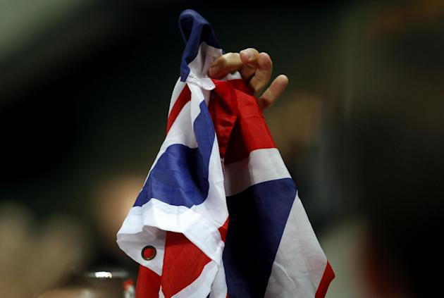 A Gibraltar supporter holds a British flag during a friendly soccer match between Gibraltar and Slovakia at the Algarve stadium in Faro, southern Portugal, Tuesday, Nov. 19, 2013. Gibraltar played its