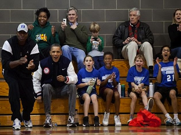 President Barack Obama cheers from the sideline during a Vipers game — White House photo/Pete Souza