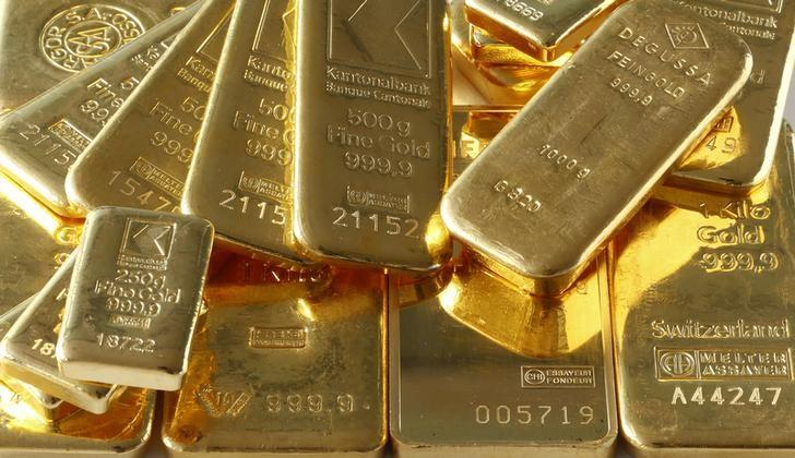 Gold price surges to highest level since June as share prices slide