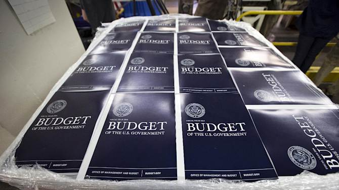 FILE - In this April 8, 2013 file photo, copies of President Barack Obama's proposed federal budget plan for fiscal year 2014 are prepared for delivery at the U.S. Government Printing Office in Washington. With Congress increasingly unable to resolve budget disputes, federal programs on automatic pilot are consuming ever larger amounts of government resources. The trend helps older Americans, who receive the bulk of Social Security and Medicare benefits, at the expense of younger people. (AP Photo/J. Scott Applewhite, File)