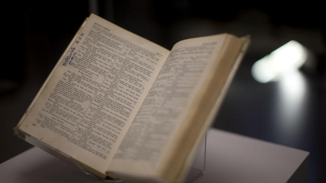 "A copy of the ""Complete Works of Shakespeare"" is displayed and signed by Nelson Mandela and owned by Sonny Venkatrathnam, who was imprisoned on Robben Island in South Africa, during the press view of the ""Shakespeare: staging the world"" exhibition at the British Museum in London, Wednesday, July 18, 2012. The exhibition, which is being held as part of the London 2012 cultural Olympiad, provides a unique insight into the emerging role of London as a world city 400 years ago, seen through the innovative perspective of Shakespeare's plays.  It runs from July 19 to November 25. (AP Photo/Matt Dunham)"