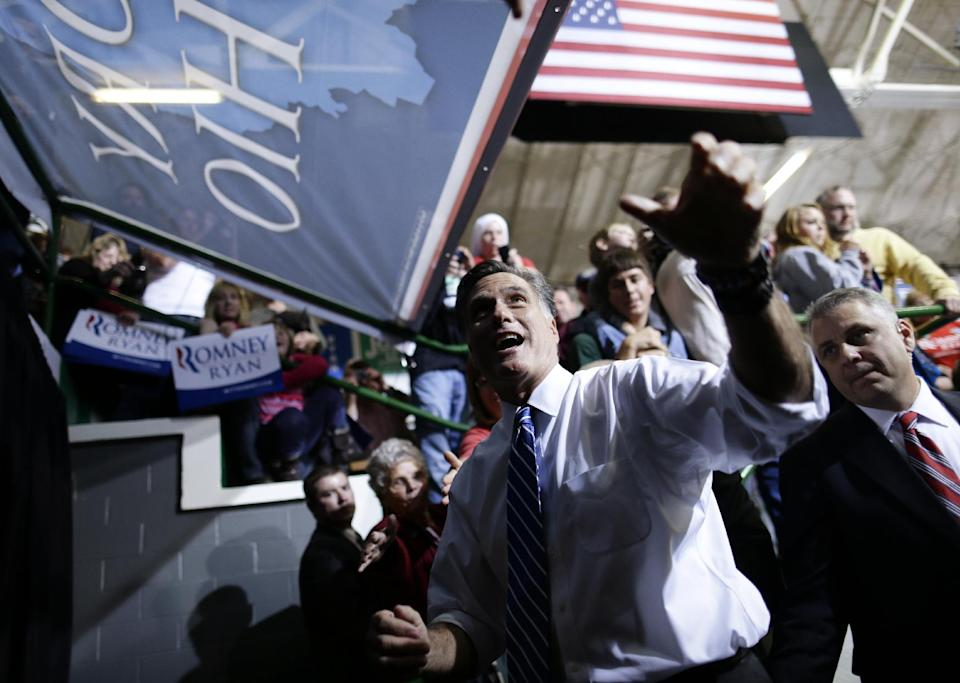Republican presidential candidate and former Massachusetts Gov. Mitt Romney looks up towards the crowd as he leaves a campaign rally at the Celina Fieldhouse in Celina, Ohio, Sunday, Oct. 28, 2012. (AP Photo/Charles Dharapak)