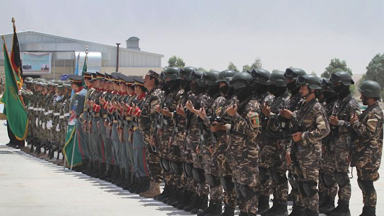 Afghan security forces stand in formation during the third phase of transfer of authority from NATO troops to Afghan security forces in Kandahar south of Kabul, Afghanistan on Wednesday, July 18, 2012. Afghan security forces received the security responsibilities of Daman, Arghandab and Dand districts of Kandahar from the NATO forces. The process of taking over security from the NATO-led ISAF forces by Afghan troops should be completed by the end of 2014, when Afghanistan will take over the full leadership of its own security duties from U.S. and NATO forces. (AP Photo/Allauddin Khan)