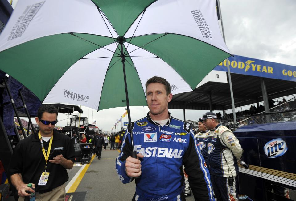 Carl Edwards walks down pit road as the leader during a rain delay in the NASCAR Sprint Cup Series Aaron's 499 auto race at Talladega Superspeedway in Talladega, Ala., Sunday, May 5, 2013. (AP Photo/Rainier Ehrhardt)