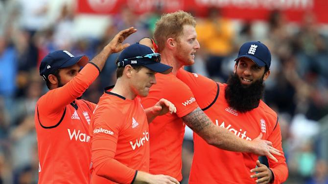 England's Adil Rashid (L), Eoin Morgan (2nd L) and Moeen Ali (R) congratulate Ben Stokes (2nd R) during his three-wicket, last over during the T20 International match against Australia in Cardiff on August 31, 2015