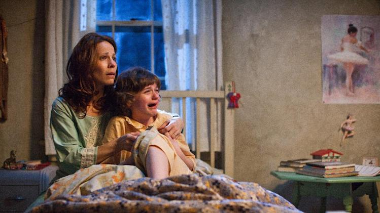 "In this publicity image released by Warner Bros. Pictures, Lili Taylor portrays Carolyn Perron, left, and Joey King portrays Christine in a scene from ""The Conjuring."" The films opens nationwide on Friday, July 19.(AP Photo/New Line Cinema/Warner Bros. Pictures, Michael Tackett)"