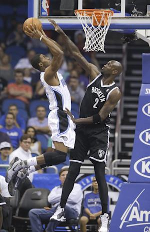 Magic hold off Nets to win second straight