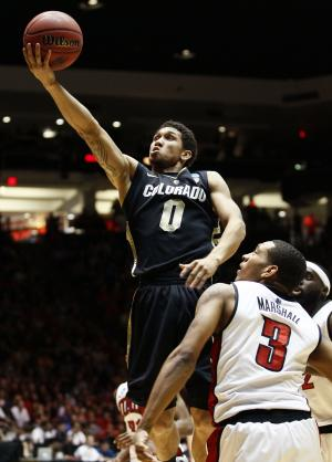 Colorado guard Askia Booker (0) drives past UNLV  guard Anthony Marshall (3) during the first half of an NCAA men's college basketball tournament second-round game Thursday, March 15, 2012, in Albuquerque, N.M. (AP Photo/Matt York)