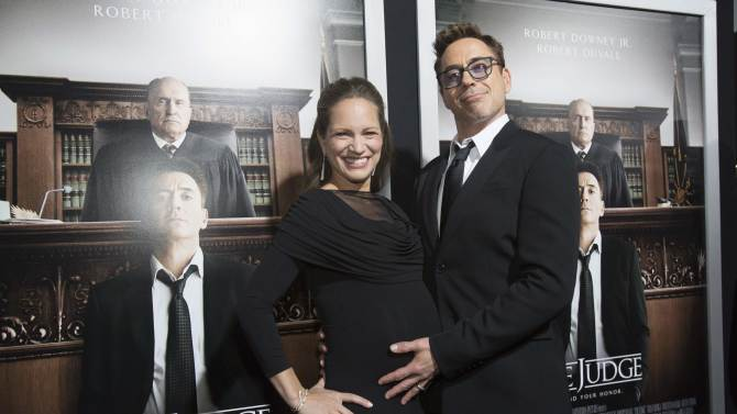 "Cast member Downey Jr. poses with his wife and producer of the movie Susan Downey at the premiere of ""The Judge"" at the Academy of Motion Picture Arts and Sciences in Beverly Hills"
