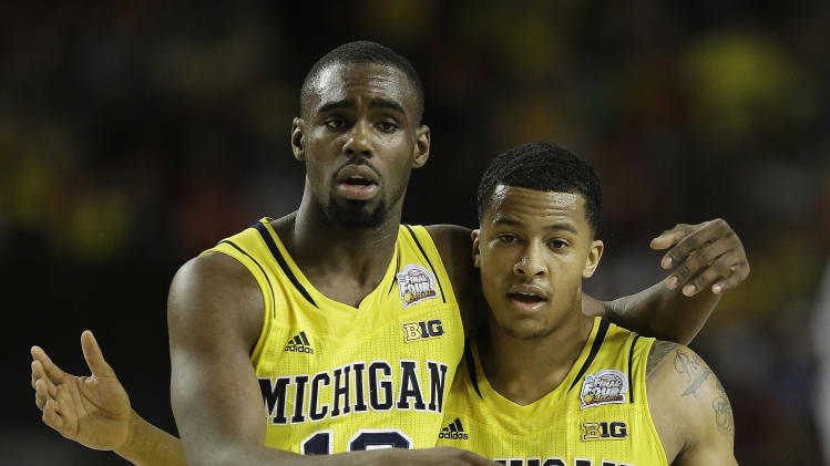 Michigan's Trey Burke, right, and Michigan's Tim Hardaway Jr. walk down the court during the second half of the NCAA Final Four tournament college basketball semifinal game against Syracuse, Saturday, April 6, 2013, in Atlanta. (AP Photo/Charlie Neibergall)