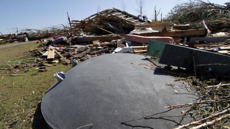 A storm shelter in the front yard of Junior and Jeannette Wiginton of Hackleburg, Ala., helped protect their family from Wednesday's tornado touchdown that destroyed their home and much of the town, as photographed Friday, April 29, 2011. (AP Photo/Rogelio V. Solis)