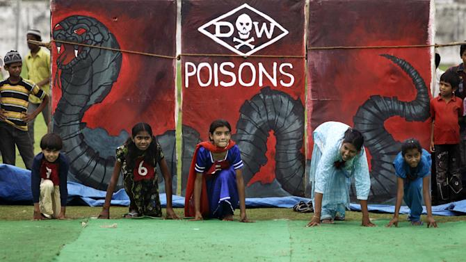 "Children suffering with birth defects compete in a 25 meters sprint event during a ""Special Olympics"" held by the survivors of the deadly 1984 Bhopal gas leak in an effort to shame Olympic sponsor Dow Chemical Co. on the eve of the London Games in Bhopal, India, Thursday, July 26, 2012. Survivors say Dow owes them compensation for the world's worst industrial disaster and have campaigned to have the chemical giant dropped as a sponsor of the Olympics. Dow says it has no liability because it bought the company responsible for the plant more than a decade after the cases had been settled. (AP Photo/Altaf Qadri)"
