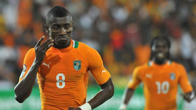 FOOTBALL Salomon Kalou celebrates scoring against Burkina Faso as Ivory Coast qualify for the quarter-finals of the African Cup of Nations