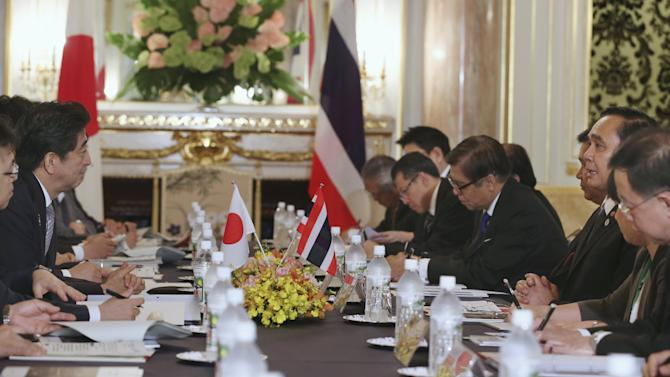 Abe talks with Chan-ocha during a bilateral talks on the sidelines of 7th Mekong-Japan Summit meeting at the Akasaka State Guest House in Tokyo