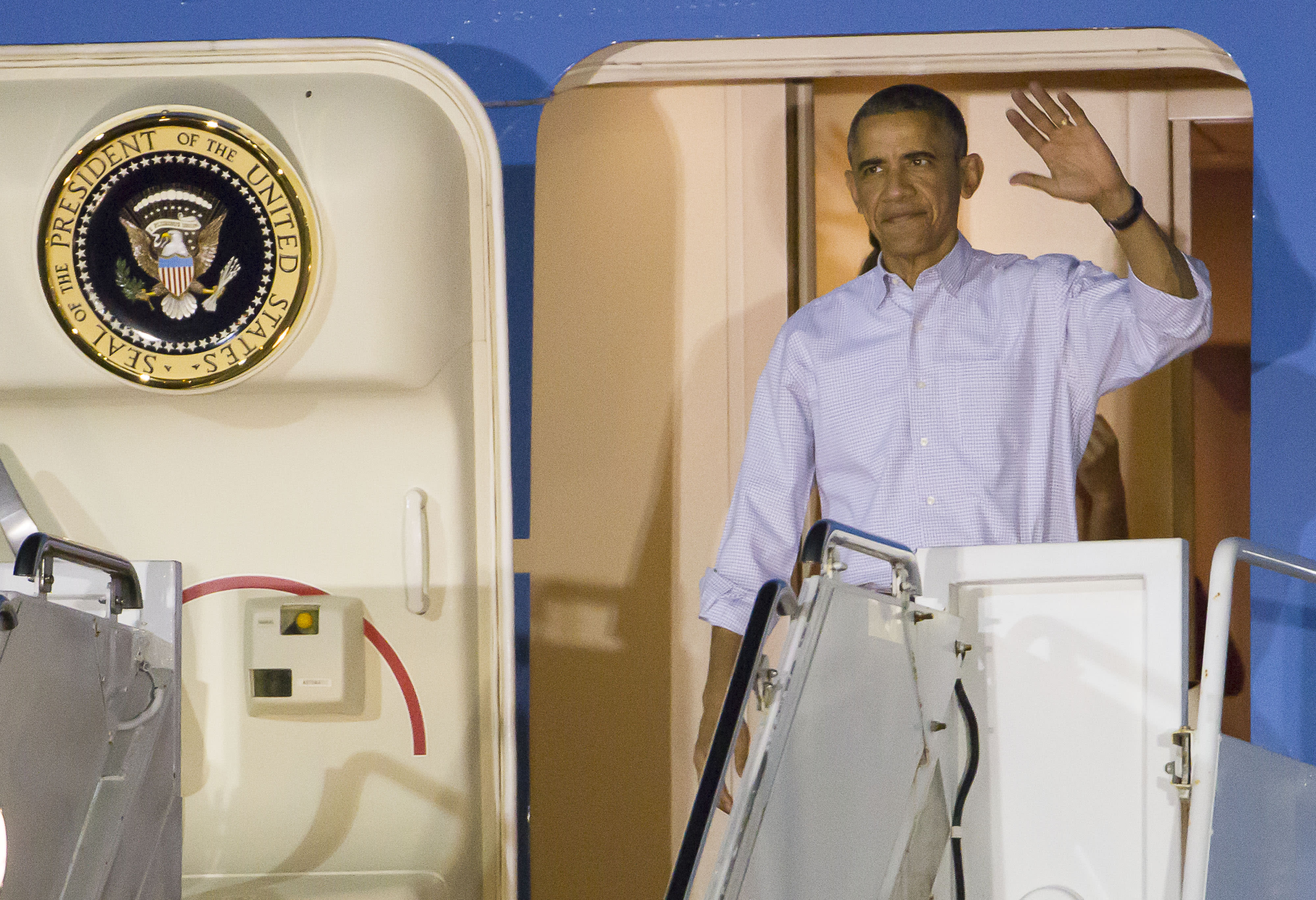 After turbulent year, Obama aims for quiet Hawaii getaway
