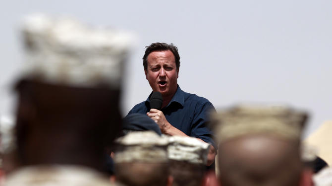 Britain's Prime Minister David Cameron delivers a speech at British and US troops during a visit at Camp Bastion, outside Lashkar Gah, the provincial capital of Helmand province in south Afghanistan, Monday, July 4, 2011. (AP Photo/Lefteris Pitarakis, pool)