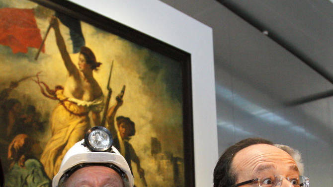 """France's President Francois Hollande, right, is seen with a former miner, Lucien Laurent in front of """" La Liberte Guidant le Peuple"""", a painting by Eugene Delacroix during the inauguration of the Louvre Museum in Lens, northern France, Tuesday, Dec. 4, 2012.  The museum in Lens is to open on Dec. 12, as part of a strategy to spread art beyond the traditional bastions of culture in Paris to new audiences in the provinces. (AP Photo/Michel Spingler, Pool)"""