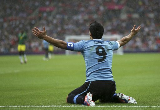 Uruguay's Luis Suarez reacts during their men's preliminary first round Group A soccer match against Senegal at the London 2012 Olympic Games in the Wembley Stadium in London