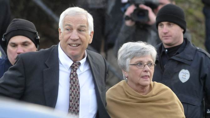 Former Penn State assistant football coach Jerry Sandusky and his wife Dottie arrive for a preliminary hearing at Centre County Courthouse in Bellefonte