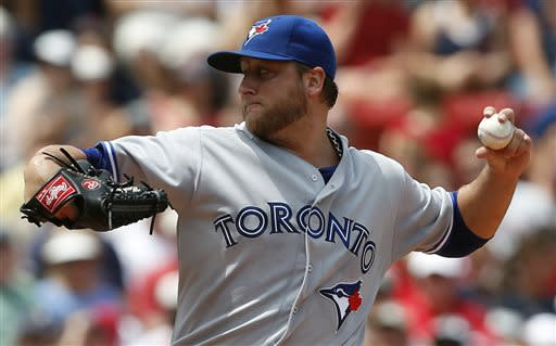 Thole's error gives Red Sox 5-4 win over Blue Jays