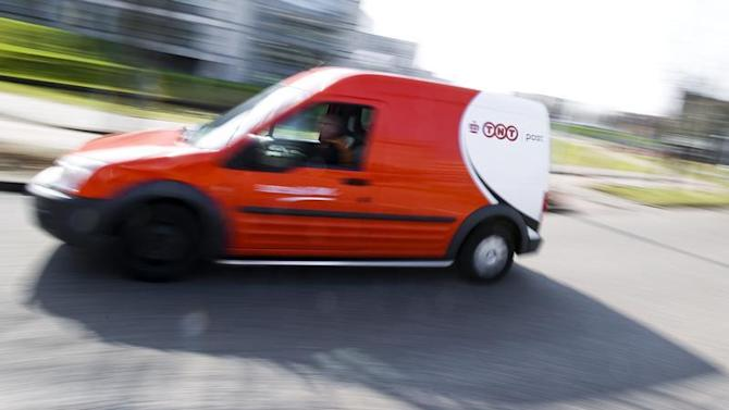 A courier van of TNT is driven in Hoofddorp