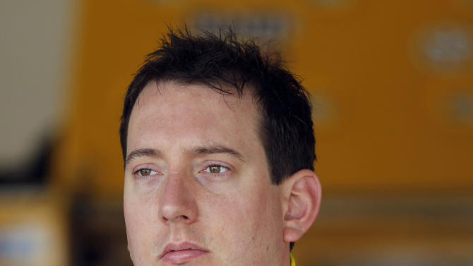 Kyle Busch looks from the garage area during practice for Sunday's NASCAR Daytona 500 auto race in Daytona Beach, Fla., Wednesday, Feb. 22, 2012. (AP Photo/Terry Renna)