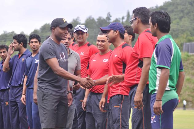 West Indies cricketer Brain Lara meets the students of Doon School in Dehradun on Oct. 3, 2013. A cricket match was organised between Doon School and Lara's team to raise funds for Kedarnath flood vic