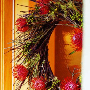 Spanish moss, canella berries, and pincushion proteas