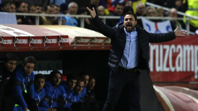 Espanyol's coach Gonzalez reacts during their Spanish King's Cup quarterfinal second leg soccer match against Sevilla in Seville