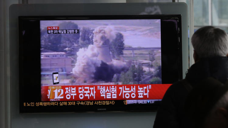 """A South Korean man watches a TV news showing a file footage of North Korea's nuclear test at the Seoul train station in Seoul, South Korea, Tuesday, Feb. 12, 2013. The U.S. Geological Survey on Tuesday detected a magnitude 4.9 earthquake in North Korea. Neither Pyongyang nor Seoul confirmed whether North Korea had conducted its widely anticipated third nuclear test, though an analyst in Seoul said a nuclear detonation was a """"high possibility."""" (AP Photo/Lee Jin-man)"""