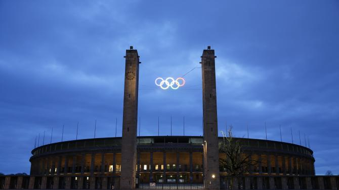 A general view shows the Olympic stadium with the illuminated Olympic rings in Berlin