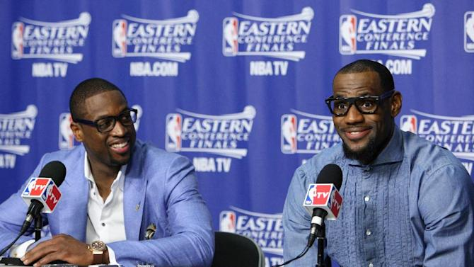 Miami Heat's LeBron James, right, and Dwyane Wade a post game news conference after Game 7 of the NBA basketball playoffs Eastern Conference finals, Saturday, June 9, 2012, in Miami. The Heat defeated the Celtics 101-88.  (AP Photo/Wilfredo Lee)