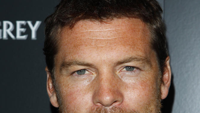 """In this photo taken Jan. 19, 2012, actor Sam Worthington attends the Cinema Society premiere of """"Man on a Ledge"""" in New York. """"We've All Been There,"""" an Australian film about a woman in need benefiting from the kindness of others, has won top honors at the world's biggest short-film festival. Director Nicholas Clifford received the Tropfest first-place award from judging panelist and """"Avatar"""" actor Sam Worthington. Worthington earlier said, """"It's not about budget, it's not about box office, it's about pure entertainment and that to me is what film should be about. Not all that other junk."""" (AP Photo/Peter Kramer)"""