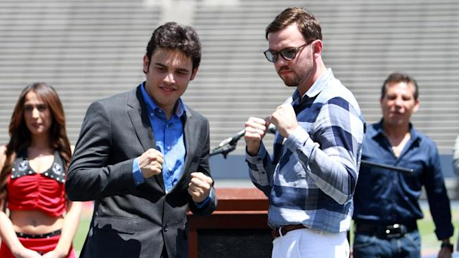 """FILE - In this April 24, 2012, file photo Julio Cesar Chavez Jr. left, and his opponent Andy Lee pose for pictures during a news conference at Sun Bowl Stadium in El Paso, Texas. A federal risk assessment of the West Texas boxing match between the two that had been cancelled, predicted it would draw leaders from two rival drug cartels, but noted the cartels had declared the event a """"neutral zone,"""" a law enforcement official told The Associated Press on Friday, April 27, 2012. (AP Photo/El Paso Times, Rudy Guteirrez, File)"""