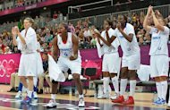 French players cheer their teammates during the Women&#39;s preliminary round group B basketball match of the London 2012 Olympic Games France vs Australia at the basketball arena in London. France won 74 to 70