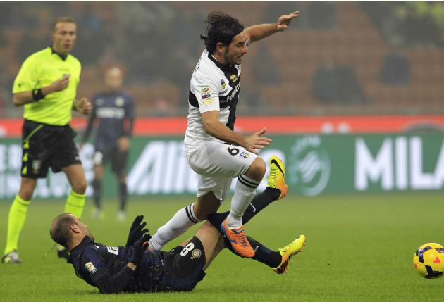 Inter Milan's Palacio tackles Parma's Lucarelli during their Italian Serie A soccer match in Milan