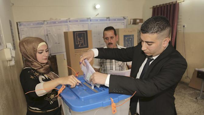 An Iraqi man casts his vote at a polling station in Baghdad, Iraq, Wednesday, April 30, 2014. A key election for a new Iraqi parliament was underway on Wednesday amid a massive security operation as the country continued to slide deeper into sectarian violence more than two years after U.S. forces left the country. (AP Photo/Khalid Mohammed)