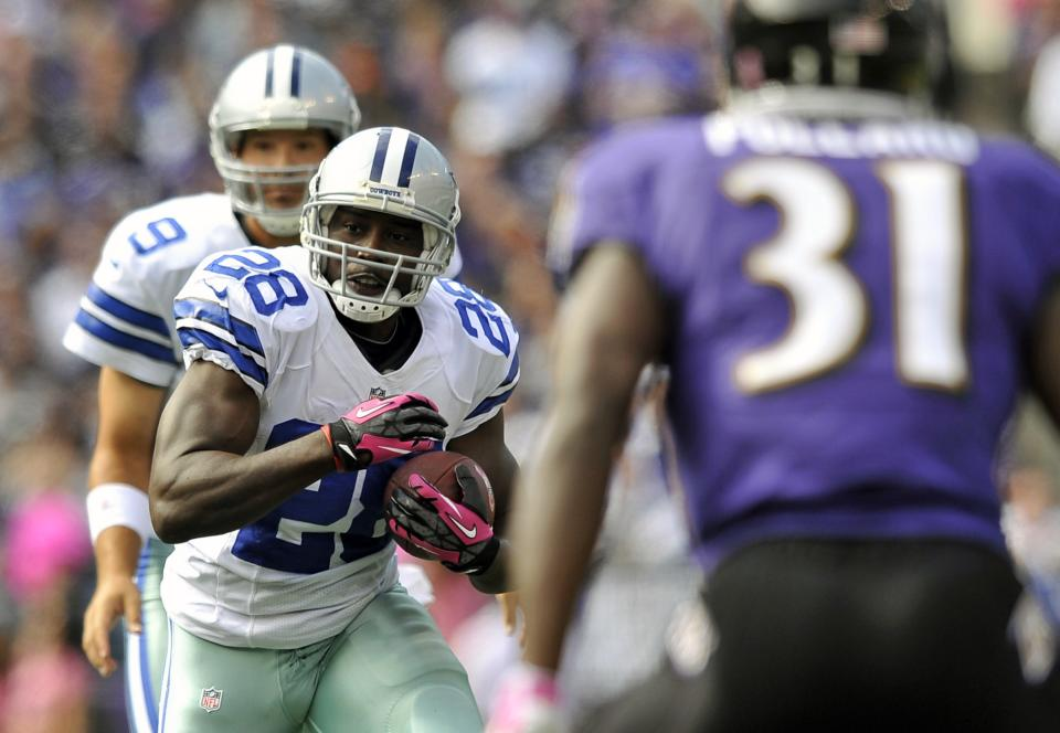 Dallas Cowboys running back Felix Jones (28) rushes for a touchdown in the first half of an NFL football game against the Baltimore Ravens in Baltimore, Sunday, Oct. 14, 2012. (AP Photo/Gail Burton)