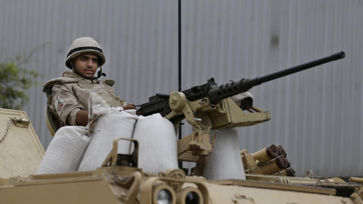 FILE - In this file photo taken Friday, Aug. 16, 2013, an Egyptian Army soldier takes his position on top of an armored vehicle while guarding an entrance to Tahrir Square in Cairo, Egypt. Israel is carefully watching events in Egypt and keeping in touch with the Egyptian army through the Arab nation's latest turmoil, officials say, working together in the common battle against Islamic militants. (AP Photo/Hassan Ammar, File)