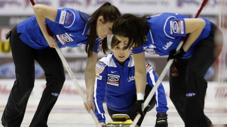 Skip Allison Pottinger of the United States delivers a stone during her draw against Denmark at the World Women's Curling Championships in St.John