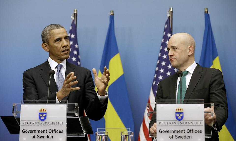 President Barack Obama, accompanied by Swedish Prime Minister Fredrik Reinfeldt, gestures during their joint news conference at the Rosenbad Building, Wednesday, Sept. 4, 2013, in Stockholm, Sweden. (AP Photo/Pablo Martinez Monsivais)