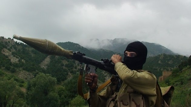 In this photo taken on Aug. 5, 2012, a Pakistani Taliban militant holds a rocket-propelled grenade at the Taliban stronghold of Shawal, South Waziristan, Pakistan. Taliban leaders will hold a meeting to decide whether a Pakistani cricket star-turned-politician Imran Khan will be allowed to hold a planned march to their tribal stronghold to protest U.S. drone strikes, the militant group&#39;s spokesman said Thursday. (AP Photo/ Ishtiaq Mahsud)